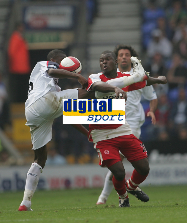 Photo: Andi Thompson.<br />Bolton Wanderers v Middlesbrough. The Barclays Premiership. 16/09/2006.<br />Boro's Yakubu (C) finds his way blocked by Bolton's Abdoulaye Faye.
