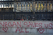 Graffiti left by vegans on the outer perimeter wall of the the UK Governments Palaces of Westminster, on 14th November 2018, in London, England.