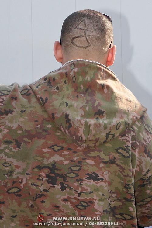 NLD/Amsterdam/20110430 - Koninginnedagconcert Radio 538, Afrojack, Nick van de Wall  met zijn logo in zijn haar