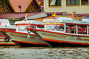 "17 NOVEMBER 2012 - BANGKOK, THAILAND:  Chao Phraya Express Boats at the line's southern terminal stop in Bangkok. Bangkok used to be known as the ""Venice of the East"" because of the number of waterways the criss crossed the city. Now most of the waterways have been filled in but boats and ships still play an important role in daily life in Bangkok. Thousands of people commute to work daily on the Chao Phraya Express Boats and fast boats that ply Khlong Saen Saeb or use boats to get around on the canals on the Thonburi side of the river. Boats are used to haul commodities through the city to deep water ports for export.    PHOTO BY JACK KURTZ"