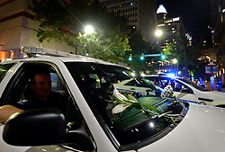 Protesters placed flowers on the windshield of a Charlotte police car as they marched through the streets of Charlotte, NC, USA, on Friday, September 23, 2016, as demonstrations continue following the shooting death of Keith Scott by police earlier in the week. Photo by Jeff Siner/Charlotte Observer/TNS/ABACAPRESS.COM