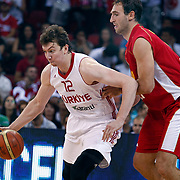 Turkey's Omer Faruk ASIK (L) during their Istanbul CUP 2011match played Montenegro between Turkey at Abdi Ipekci Arena in Istanbul, Turkey on 25 August 2011. Photo by TURKPIX