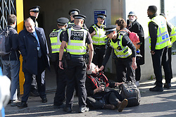 © Licensed to London News Pictures. 10/10/2019. London UK: Extinction Rebellion protesters move east across the capital to London City airport. Police are stopping protesters from shutting down the airport as their campaign enters its forth day , Photo credit: Steve Poston/LNP