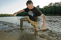 Behind the scene shot of the photographer, Milan Radisics on the location, the river Tisza, Hungary