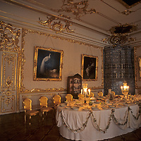 Lavish ornamentation and tableware at Catherine's Palace demonstrate the opulence enjoyed by Russia's Czars. This palace at Pushkin (Tsarskoye Selo) was first built in 1717 for Catherine I, but repeatedly rebuilt and/or destroyed.  It has been rebuilt after World War II as a museum.