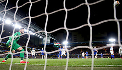 Chelsea's Willian (not in picture) scores his side's second goal of the game as Dynamo Kiev's goalkeeper Denys Boyko (left) looks on during the UEFA Europa League, round of 16 first leg match at Stamford Bridge, London.