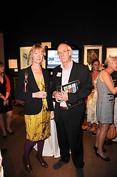 ROGER McGOUGH and his wife HILARY at an auction and priavte view of paintings, drawings, stories and doodles by well known personalities held at Christie's, St.James's, London on 20th September 2010.