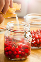 Adding Sugar to Cherries in Mason Jar