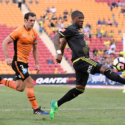 BRISBANE, AUSTRALIA - APRIL 16: Roly Bonevacia of the Phoenix controls the ball under pressure from Luke DeVere of the Roar during the round 27 Hyundai A-League match between the Brisbane Roar and Wellington Phoenix at Suncorp Stadium on April 16, 2017 in Brisbane, Australia. (Photo by Patrick Kearney/Brisbane Roar)