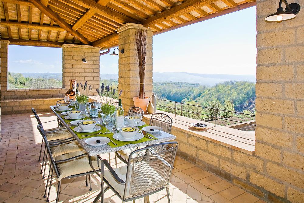 Villa San Donato in Italy, on the border between Tuscany and Lazio. The loggia runs across the rear of the villa.