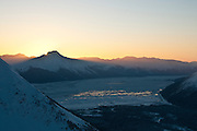 Winter skiing at the Alyeska ski resort at sunset in the Chugach Mtns.