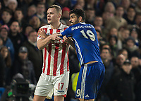 Football - 2016 / 2017 Premier League - Chelsea vs. Stoke City <br /> <br /> Ryan Shawcross of Stoke City keeps a hold of Diego Costa of Chelsea shortly before they lock heads at Stamford Bridge.<br /> <br /> COLORSPORT/DANIEL BEARHAM