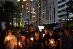 June 4, 2017 - Hong Kong - Tens of thousands of people attend an annual candlelight vigil at Hong Kong's Victoria Park to commemorate victims of 1989 Tiananmen Square Massacre. (Credit Image: © Sun Yeung/Pacific Press via ZUMA Wire)