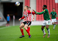 Football - 2020 / 2021 Sky Bet League One - Sunderland vs Lincoln City - Stadium of Light<br /> <br /> Max Power of Sunderland vies with Tayo Edun of Lincoln City<br /> <br /> Credit: COLORSPORT/BRUCE WHITE