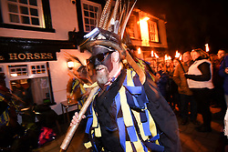 © London News Pictures. 05/01/2018. Hartley Wintney, UK. Hook Eagle Morris Men take part in  a torch-lit parade as part of a Wassailing tradition in the town of Hartley Wintney in Hampshire, England. Wassail is a traditional Pagan winter celebration in cider-producing regions of England, reciting incantations and singing to the trees to promote a good harvest for the coming year. Photo credit: Ian Longthorne/LNP