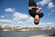 Parkour runner shows urban acrobatic skills flying upside down. The South Bank is a significant arts and entertainment district, and home to an endless list of activities for Londoners, visitors and tourists alike.