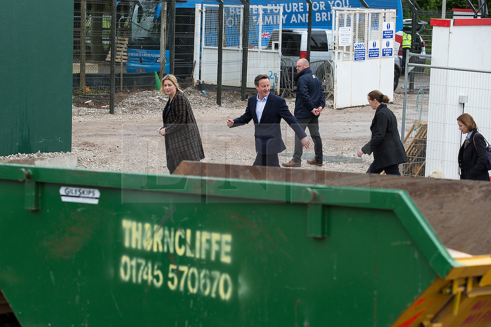 © Licensed to London News Pictures . 06/05/2015 . Chester , UK . Press photographers are held back 30 metres as the Conservative Party Leader DAVID CAMERON (2nd from left) leaves a building site for an extension at Chester Zoo on the final day of the election campaign . Photo credit : Joel Goodman/LNP