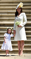 Meghan Markle's mother Doria Ragland, the Prince of Wales, the Duchess of Cornwall, Princess Charlotte and Britain's Catherine, Duchess of Cambridge leave the wedding ceremony of Prince Harry, and Meghan Markle at St George's Chapel, Windsor Castle, in Windsor.