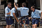 Sunny Beach, Nesebar, Bulgaria..Armed private police patrol on bicycles at Sunny Beach, the largest holiday resort in the Balkans, and a popular destination for cheap foreign package tours.