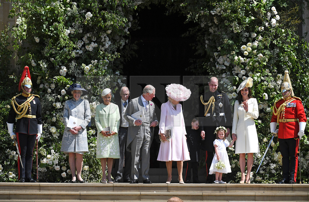 © Licensed to London News Pictures. 19/05/2018. London, UK.  DORIAN RAGLAND, mother of Meghan Markle leaves the chapel with PRINCE CHARLES, CAMILLA, DUCHESS OF CORNWALL, PRINCE GEORGE, PRINCE WILLIAM, PRINCESS CHARLOTTE and CATHERINE, DUCHESS OF CAMBRIDGE, at the wedding of Prince Harry, The Duke of Sussex and Meghan Markle, The Duchess of Sussex at St George's Chapel in Windsor Castle. Photo credit: LNP