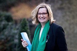 © Licensed to London News Pictures. 06/02/2018. London, UK. Home Secretary Amber Rudd arriving in Downing Street to attend a Cabinet meeting this morning. Rudd is wearing symbolic green and purple colours, as today is the 100th anniversary of women's right to vote.Photo credit : Tom Nicholson/LNP