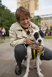 © licensed to London News Pictures. London, UK 10/10/2013. Caroline Spelman MP and her Dogs Trust rescue dog attending Westminster Dog of the Year competition with other MPs and parliamentarians' dogs on Thursday, 10 October 2013. Photo credit: Tolga Akmen/LNP