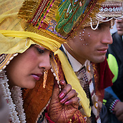 Emotional moment for the bride : she is leaving her childhood home in her village, moving away to her husband's home. Traditional wedding in the Himalaya.