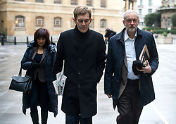 © Licensed to London News Pictures. 17/01/2016. London, UK. Labour party leader JEREMY CORBYN arriving at BBC Broadcasting House with his adviser SEUMAS MILNE (centre) and wife LAURA ALVAREZ (left) to appear on The Andrew Marr Show on BBC One. Photo credit: Ben Cawthra/LNP