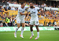 Football - 2021 / 2022 Premier League - Wolverhampton Wanderers vs Brentford - Molyneux Stadium - Saturday 198th September 2021<br /> <br /> Bryan Mbeumo of Brentford celebrates scoring goal no.2 with Sergi Canos<br /> <br /> Credit : COLORSPORT/Andrew Cowie