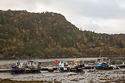 Fishing boats in the village of Plockton on the 4th November 2018 in western Scotland in the United Kingdom. Plockton is a village in the Highlands of Scotland in Lochalsh, Wester Ross with a population of 378. Plockton is a settlement on the shores of Loch Carron.