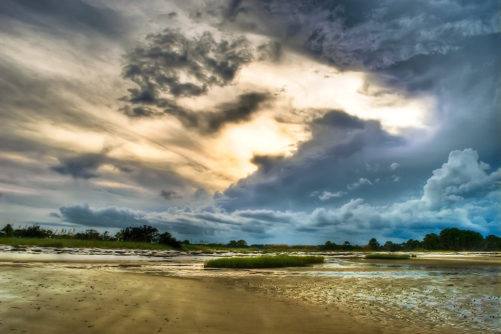 A fantastic cloudscape at the beach in the evening. Nothing more beautiful than a sunset with an incoming storm on the beach!