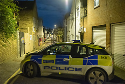 © Licensed to London News Pictures. 05/12/2019. London , UK. A Police car forms a cordon on Clarence Mews, a police tent sits in the background as investigators gather evidence at the scene of a fatal stabbing in Hackney. Police were called at 14:01 GMT and attended alongside London Ambulance Service and London's Air Ambulance where they found a man seriously injured. Despite their best efforts the man - believed to be aged in his 20s - was pronounced dead at the scene at 14:33hrs. Photo credit: Peter Manning/LNP
