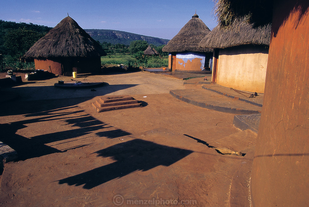 Late afternoon laundry shadows play on the courtyard of a typical family compound in the village of Masetoni in Venda, in the far northeast of South Africa. (Man Eating Bugs page 122,123)