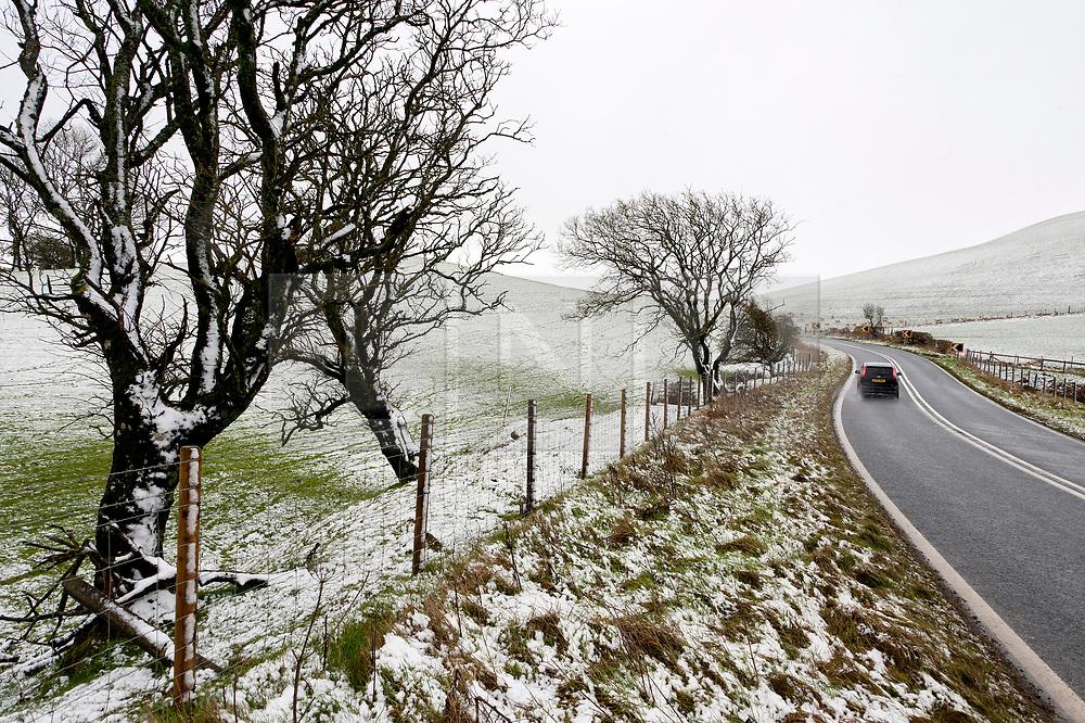 © Licensed to London News Pictures. 27/01/2019.  Llanfihangel-nant-Melan, Powys, Wales, UK. A motorist drives along the A44 road near  Llanfihangel-nant-Melan in Powys, Wales, UK. after snow fell overnight in Powys, Wales, UK. credit: Graham M. Lawrence/LNP