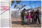 A mother sees that her daughter is safely on the two-man chair lift at Beldersay ski resort, Uzbekistan