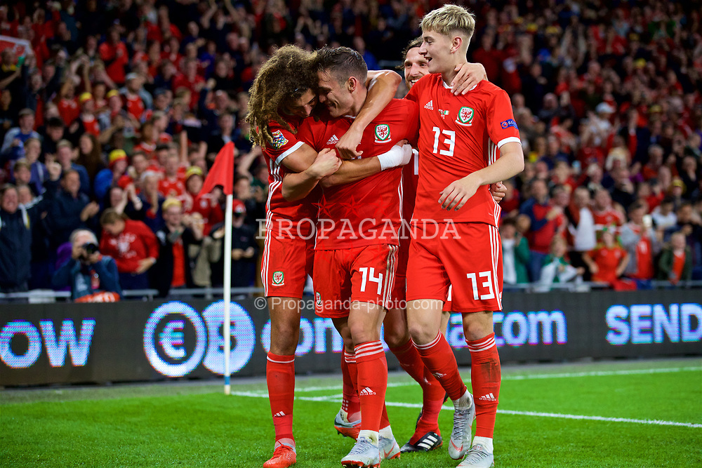 CARDIFF, WALES - Thursday, September 6, 2018: Wales' Connor Roberts (2nd left) celebrates scoring the fourth goal with team-mates Ethan Ampadu (left) and David Brooks (right) during the UEFA Nations League Group Stage League B Group 4 match between Wales and Republic of Ireland at the Cardiff City Stadium. (Pic by Paul Greenwood/Propaganda)
