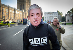 © Licensed to London News Pictures. 31/10/2019. London, UK. A man wears a mask depicting Speaker John Bercow and a sweatshirt mocking the BBC as protestors gather near Parliament on what would have been the United Kingdom's last day as a member of the European Union. The date of Brexit had been moved to January 31, 2020 after MPs failed to pass Prime Minister Boris Johnson's withdrawal agreement. Photo credit: Peter Macdiarmid/LNP