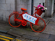 Painted bike advertising a vintage clothes shop, Muswell Hill, London, UK.