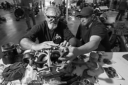 "The master at work - Carl Olsen working on one of the Cannonball bikes he built on the  Friday ""Rest Day"" between stages 7 and 8 of the Motorcycle Cannonball Cross-Country Endurance Run in Junction City, KS., USA. Friday, September 12, 2014.  Photography ©2014 Michael Lichter."