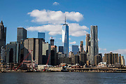 Lower Manhattan, also know as Downtown Manhattan is the financial district and centre for business, culture and government in the city of New York, United States of America. Photographed across the East River from Brooklyn.