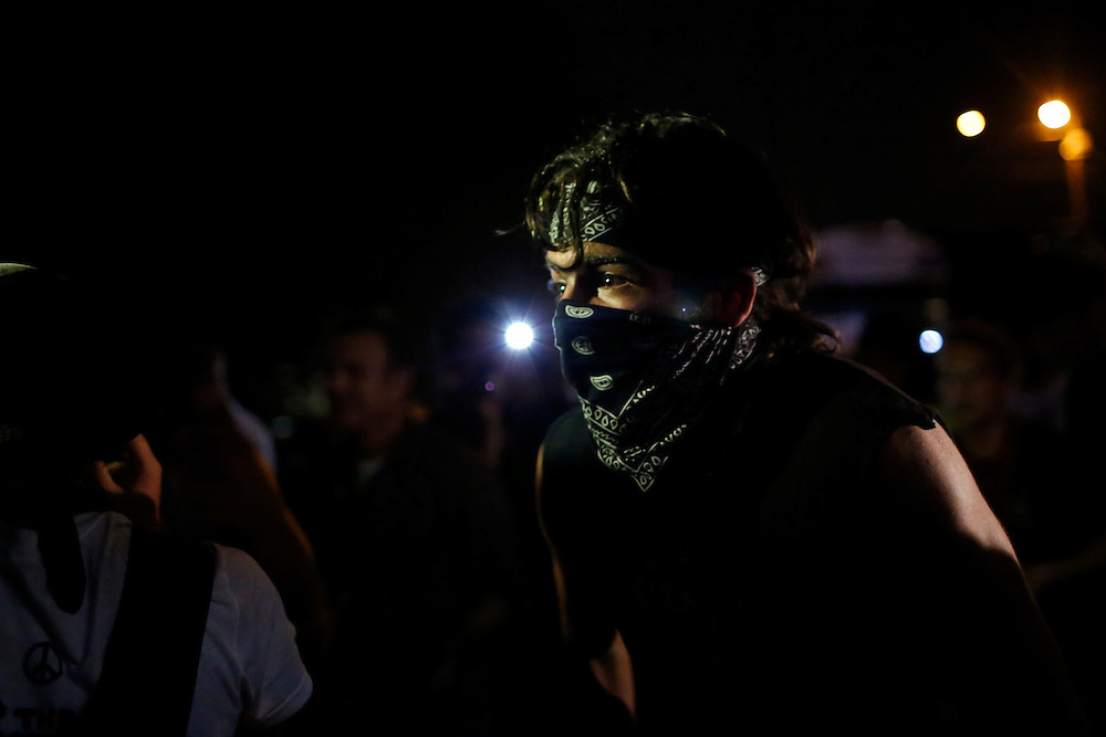 Andrew Speir celebrates after a successful face off with law enforcement in an unscheduled silent march against police brutality during the 2012 Republican National Convention on August 29, 2012.