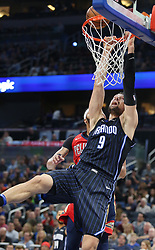 December 22, 2017 - Orlando, FL, USA - The Orlando Magic's Nikola Vucevic misses a slam dunk against the New Orleans Pelicans at the Amway Center in Orlando, Fla., on Friday, Dec. 22, 2017. (Credit Image: © Stephen M. Dowell/TNS via ZUMA Wire)