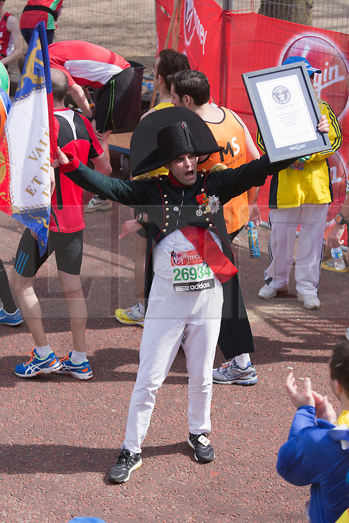 © Licensed to London News Pictures. 21/04/2013. London, England. Picture: Runner dressed as Napoleon is attempting a Guinness World Record. Celebrity Runners and Fun Runners finish the Virgin London Marathon 2013 race in the Mall, London. Many wore black ribbons to pay their respect for those who died or were injured in the Boston Marathon. Photo credit: Bettina Strenske/LNP