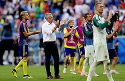 Sweden manager Janne Andersson (second left) and Sweden players applaud the fans at the end of the FIFA World Cup, Quarter Final match at the Samara Stadium.