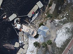 Debris from docks that were shredded and boats that were sunk litter the shoreline after Hurricane Irma passed on Tuesday, September 12, 2017, at St. Marys on the Georgia coast. Photo by Curtis Compton/Atlanta Journal-Constitution/TNS/ABACAPRESS.COM