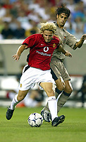 Photo Aidan Ellis.<br />Manchester United v Barcelona (at the Lincoln Financial Field Philadelphia) 03/08/03.<br />United's Diego Forlan holds of a challenge from Barcelona's Gerard Lopez