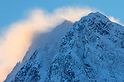 Blowing snow off a Peak of the Canadian Rocky Mountains at sunset, Banff National Park, Alberta, Canada