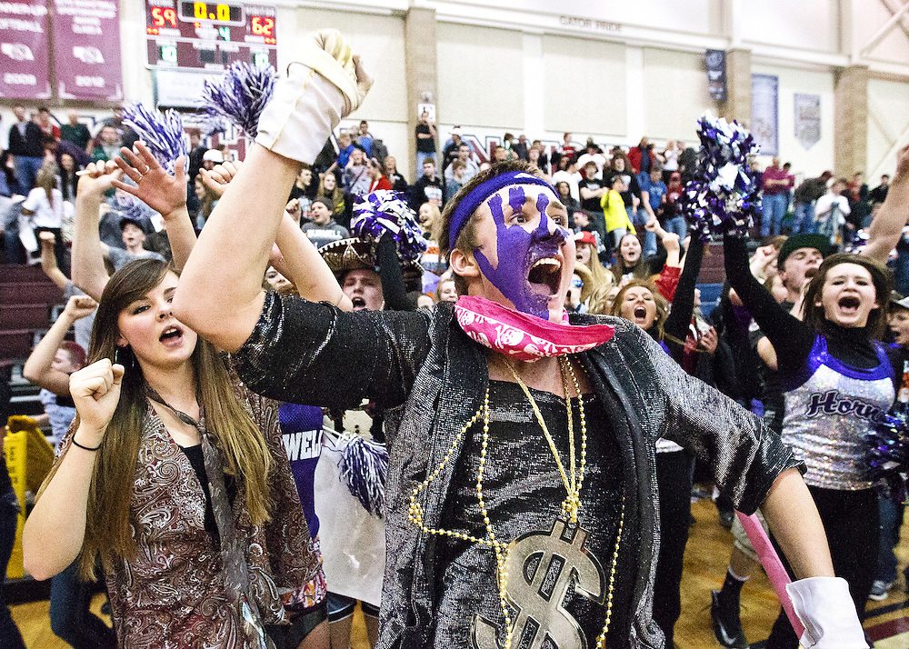 Burwell junior Keenan Darrel Kremke leads the fans in celebrating the Longhorns 62-59 overtime victory over Kenesaw in Thursday's D1 quarterfinal game at Lincoln North Star High School. (Independent/Matt Dixon)