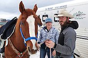 Jesse Johnston (Left) and Jamie Trip (Center) from the United States, prepare horse, Playboy (Left), for the final day of competition at the World Skijoring Championships in Whitefish, Montana on Sunday, January 29. <br /> <br /> Skijoring, which originated in Scandinavia about 700 years ago when it was a means of transport during the winter months, is a specialized competitive sport where competitors on skis are pulled by a horse, dog or motor vehicle. Only horses and mules were used in the championships. <br /> (REUTERS/Matt Mills McKnight (UNITED STATES)