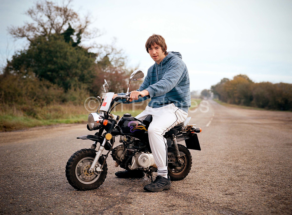 Shane Anderson on his motorised mini-bike, works at the Midway Stop Cafe along the Haughly New Road on the 20th October 2009 In Haughly in the United Kingdom. The Midway Stop serves commuters and transport community traversing the adjacent A14.